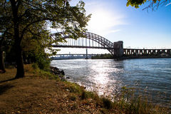The Hell Gate Bridge over the river at Astoria park Stock Images
