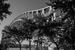Hell Gate Bridge over the river and trees at Astoria park in black and white style Royalty Free Stock Photography