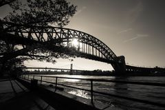 The Hell Gate Bridge and Triborough bridge over the river with walkway at Astoria park in black and white style Royalty Free Stock Photos