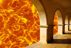 Hell Gates. Composite image of burning hell and its entrance gates stock image