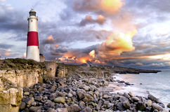 Hell at the Headland. Portland Bill lighthouse in Dorset during a dramatic sunrise. The light lasted only a few seconds before one of our many winter storms hit Stock Images