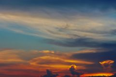 Hell in Heaven colorful Clouds Silhouette blue Sky Background Evening golden sunset.  Royalty Free Stock Image