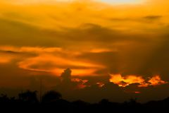 Hell in Heaven colorful Clouds Silhouette blue Sky Background Evening golden sunset.  Stock Images