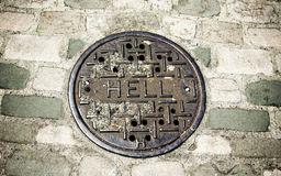Hell manhole cover Royalty Free Stock Images