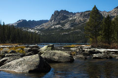 Hell Roaring Lake in October. Hell Roaring Lake as seen from the outlet stream in October. Hell Roaring Lake is surrounded by the Sawtooth Mountains of Idaho Stock Photo