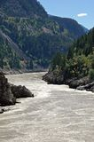 River flowing through valley Stock Images