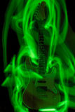 Hell's guitar. Surrounded by green flames Stock Image
