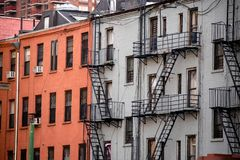 Hell`s Kitchen, New York City, typical traditional apartment buildings royalty free stock photo