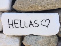 Hellas Thassos Island. Hellas written on a stone wall royalty free stock images