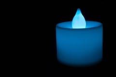Hellblaue elektrische Kerze Stockbild