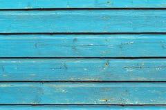 Hellblaue Farbe des alten Beschaffenheitshintergrundes des hölzernen Brettes Lizenzfreies Stockfoto