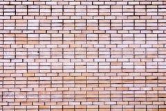 Hellbraune Backsteinmauerhintergrundbeschaffenheit Stockfotografie