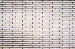 Hellbraune Backsteinmauerhintergrundbeschaffenheit Stockbild