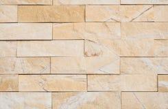 Hellbraune Steinwand-Beschaffenheit Stockbilder