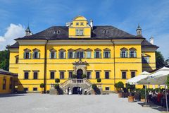 Hellbrunn Palace, summer residence of the Archbishop of Salzburg. Salzburg, Austria - May 25, 2019 : main facade of Hellbrunn Palace Schloss Hellbrunn, summer stock image