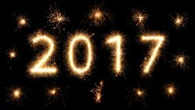 helle glühende neue Jahre 2017 der Feuerwerkswunderkerze Lizenzfreie Stockbilder
