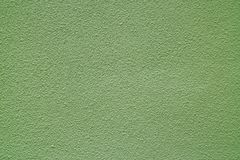 Helle Olive Green Colored Rough Concrete-Wand, Front View für Hintergrund Stockbilder