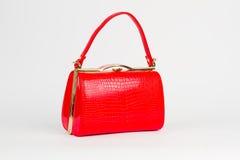Helle rote glatte Handtasche Lizenzfreie Stockfotografie