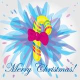 Helle Weihnachtskarte mit einem Bonbon. Stockfoto