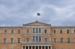 Hellenic parliament. Neoclassical building facade under cloudy sky. Athens, Greece Stock Images