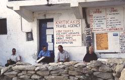 Hellenic people. Outside the travel agency in the Cyclades island of Paros Royalty Free Stock Photography