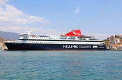 Hellenic Seaways Ferry docked to pick up new passengers at the port. KASTELLORIZO,GREECE-AUGUST 10:Hellenic Seaways Ferry docked to pick up new passengers at the royalty free stock image