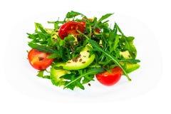 Heller diätetischer Salat vom Arugula, von der Avocado, von den tomates und vom Leinsamen Stockbild