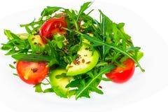 Heller diätetischer Salat vom Arugula, von der Avocado, von den tomates und vom Leinsamen Stockfoto