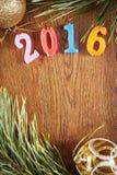 Heller hölzerner Hintergrund über guten Rutsch ins Neue Jahr 2016 Stockfoto