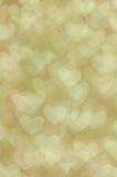 Heller Hintergrund der Defocused abstrakten goldenen Herzen Lizenzfreie Stockbilder