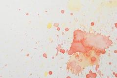 Heller roter und gelber Aquarell Splatter Stockfoto