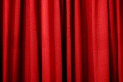 Heller roter Vorhang als Hintergrund oder Beschaffenheit Lizenzfreie Stockfotos