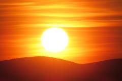Heller Sonnenuntergang lizenzfreie stockfotografie