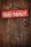 Helles Feiertagszeichen auf hölzerner Wand Lizenzfreie Stockfotos
