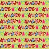 Helles Muster mit netten bunten Herzen Stockfotografie