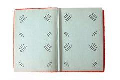 Helles offenes rotes Fotoalbum lokalisiert auf weißem Hintergrund Lizenzfreie Stockfotos
