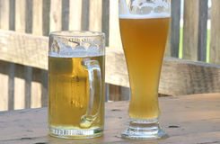Helles and weissbier. Hellesand weiss german beer Royalty Free Stock Images