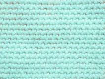 Hellfarbiger Strickpulli als Hintergrund Lizenzfreies Stockbild
