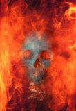 Hellfire. Skull enveloped in flames. Good for illustrating hellfire, sinners,punishment,  or gamers etc Stock Photo
