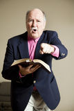 Hellfire and Brimstone Preacher. Angry preacher gives a fiery sermon in church stock image