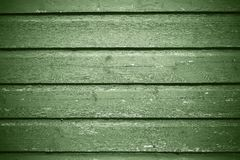 Hellgrüne Farbe des alten Beschaffenheitshintergrundes des hölzernen Brettes Lizenzfreies Stockfoto