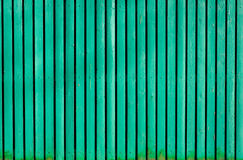 Hellgrüner alter hölzerner gemalter Zaun Lizenzfreie Stockfotografie