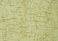 Hellgrüner rauer Gips auf Wandnahaufnahme Stockfotografie
