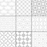 Hellgraue geometrische Verzierungen Ansammlung nahtlose Muster Stockbild