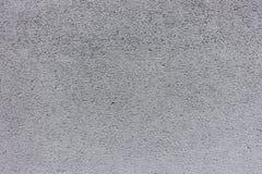 Hellgraue raue gemalte Betonmauerbeschaffenheit Stockfotografie