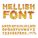 Hellish font. inferno ABC. Fire letters. Sinners in hellfire.  H. Ell Alphabet. Scrape down flame for sins. torture skeletons Royalty Free Stock Photo