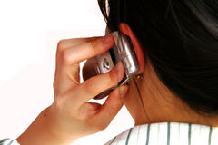 Hello. Asian woman talking in mobile phone stock images