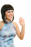 Hello. Smiling woman is saluting on white background Royalty Free Stock Photos