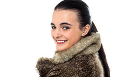 Hello, anyone called me ?. Teen girl in fur jacket, looking over shoulder Stock Photography