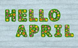 Hello April inscription from the letters of grass with flowers a royalty free illustration